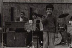 Haik singing with an orchestra in 1988 (he is 6).