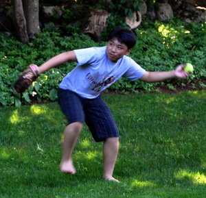 George Li playing baseball.