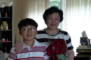 George and his teacher Mrs Dorothy Shi.