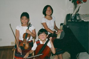 "At Michiaki's house in Barcelona, Spain (2011), with his two sisters forming a trio ""Petit Amadeus."""